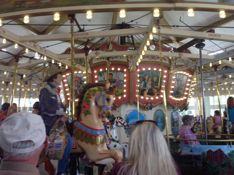 Rose Marie Mark rides the Berkshire Carousel in Pittsfield, Massachusetts Friday.