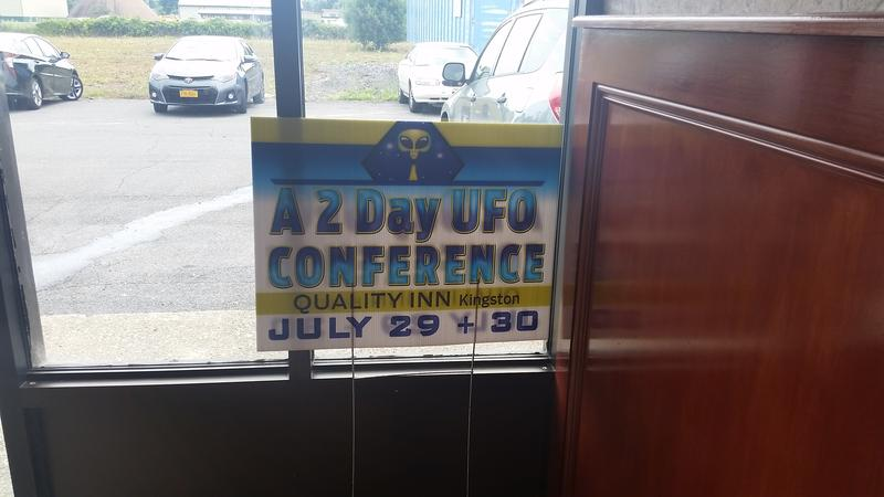 A sign points the way to the UFO Conference in Kingston