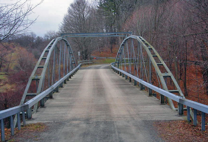 The Whipple Cast and Wrought Iron Bowstring Truss Bridge. locally known as the Normanskill Farm Bridge, is located near the entrance to Stevens Farm in southwestern Albany, New York, United States. It was built in 1867.