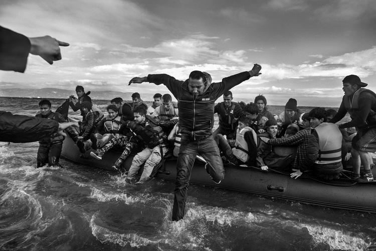 Refugees, primarily from Syria, Iraq and Afghanistan, disembark on the island of Lesvos, Greece.