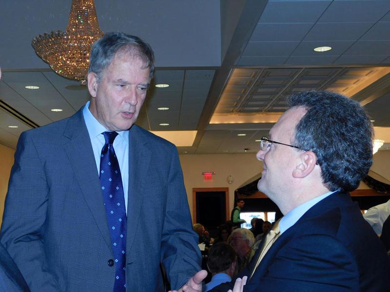 Former Congressman Bill Owens (left) chats with Warren Boley
