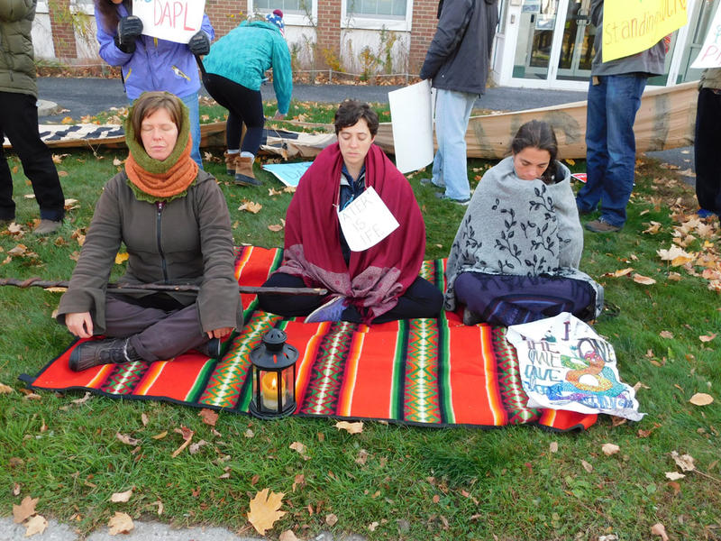 Trio meditates during Standing Rock rally in Essex Junction, VT