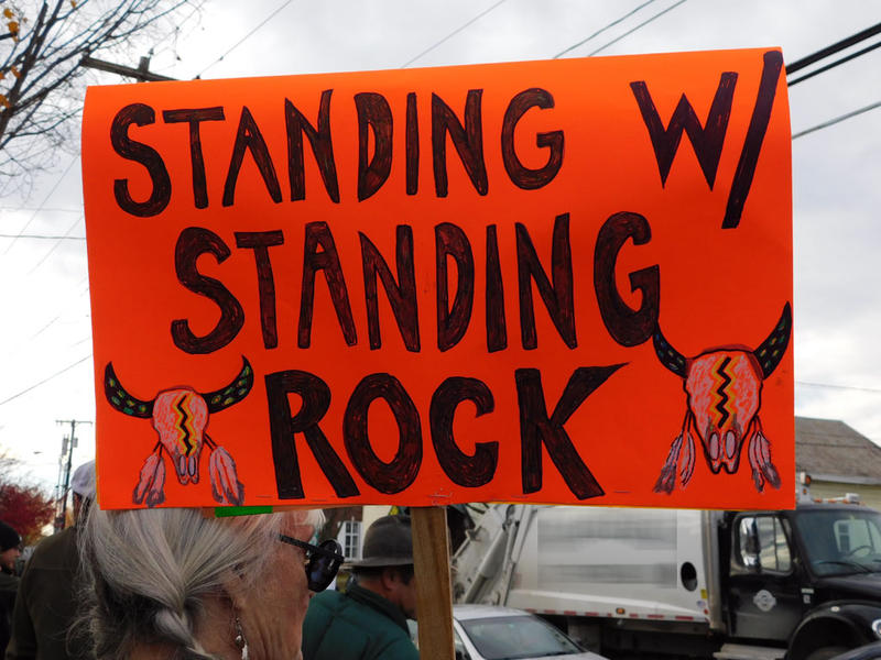 Sign held during Standing Rock rally in Essex Junction, VT