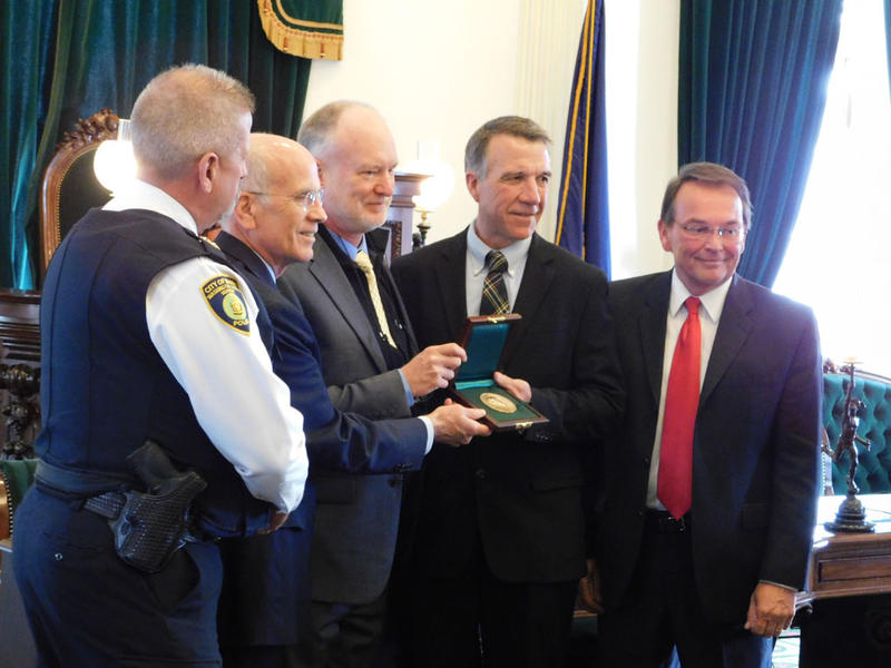 Scott Williams receives Carnegie Medal at Statehouse in Montpelier.  From left: Barre Police Chief Tim Bombardier, Congressman Peter Welch, Scott Williams, Governor-elect Phil Scott, and Barre Mayor Thom Lauzon