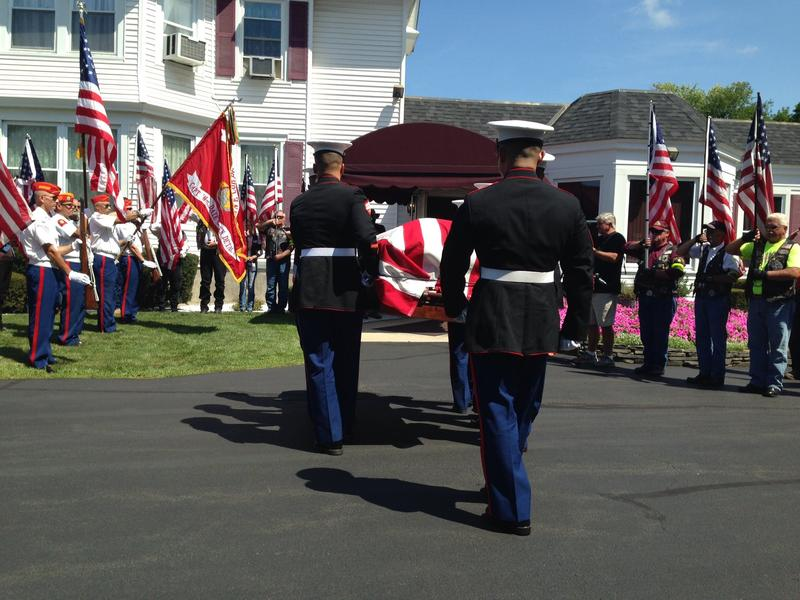Marines escort the body of PFC George H. Traver to a funeral home in Chatham, New York in August 2016