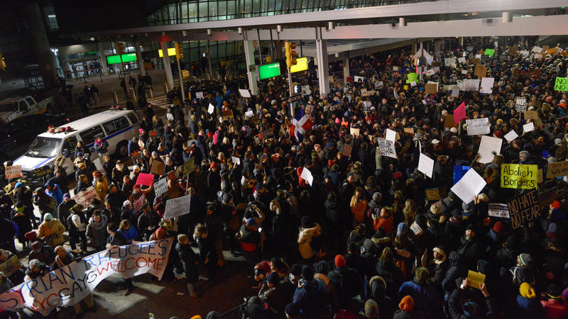 Thousands of protesters rally against the new immigration ban at John F. Kennedy International Airport in New York Saturday.