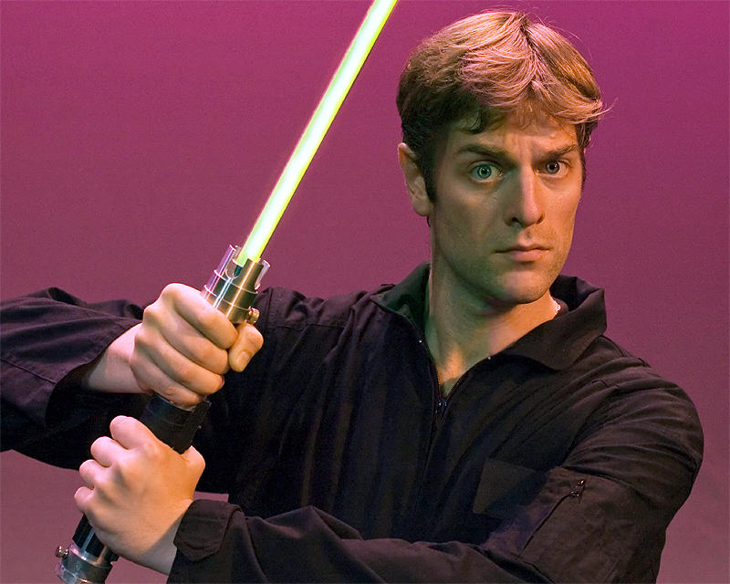 Charles Ross with a lightsaber
