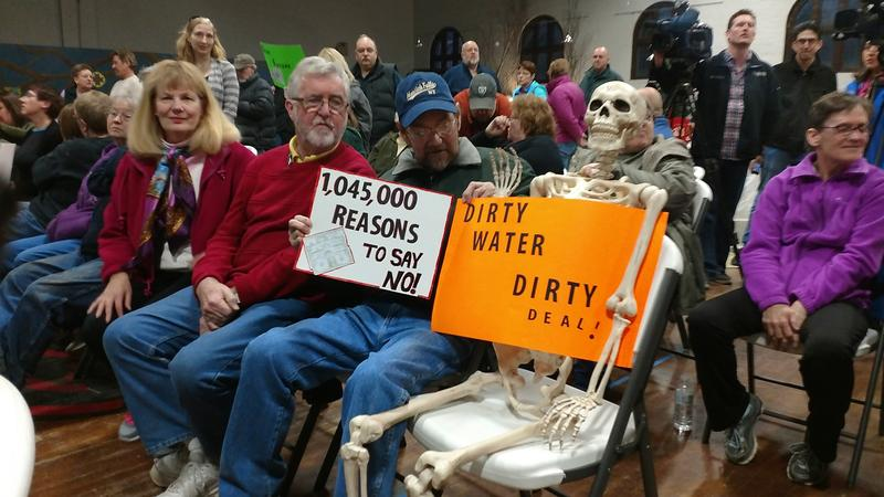 Villagers protest a revised settlement agreement between Hoosick Falls and companies Saint-Gobain and Honeywell in February 2017 (file photo)