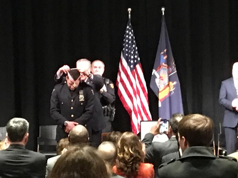 U.S. Senator Chuck Schumer awards Troy police officer Joshua Comitale  Congressional Badge of Bravery for heroism in the line of duty.