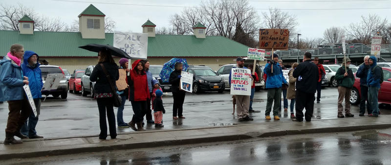 Demonstrators gather in front of Congresswoman Stefanik's Plattsburgh office