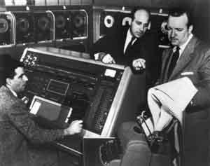 Two Remington Rand employees demonstrate the UNIVAC for Walter Cronkite in 1952