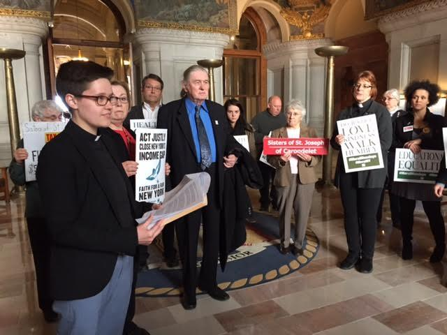 Reverend Emily McNeill of the Labor Religion Coalition and other religious leaders lobbied for extension and expansion of the state's millionaires tax in the budget