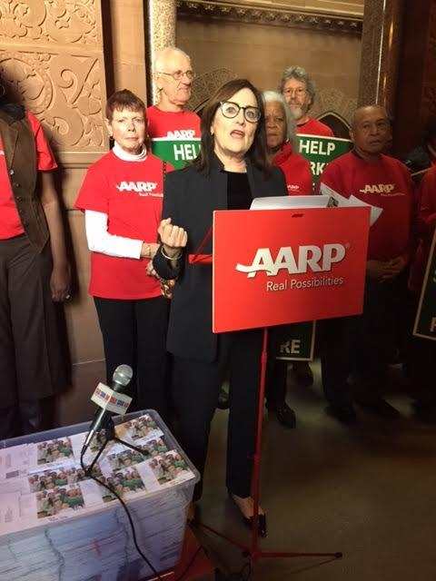 Beth Finkel, AARP New York State Director , stands with 10,000 postcards the group delivered to lawmakers , urging support for a new retirement plan option for those without pensions or 401k's