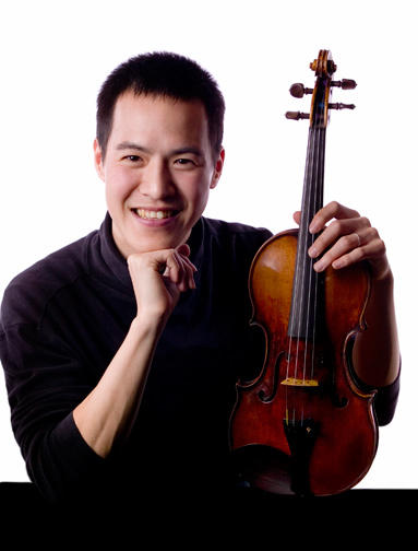 Joseph Lin holding his violin