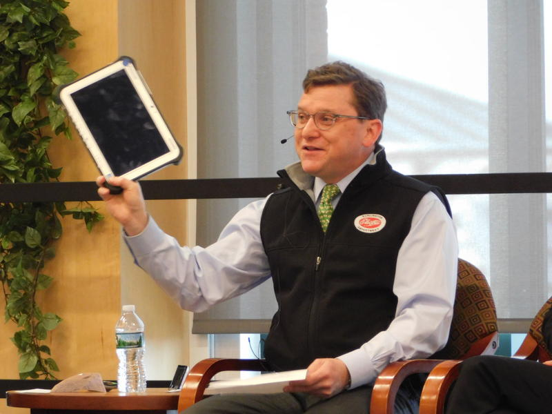 Burlington Electric General Manager Neale Lunderville holds laptop that led to hacking report