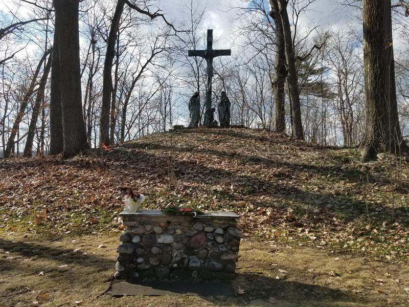 A monument overlooks the Jesuit cemetery behind Roth Hall