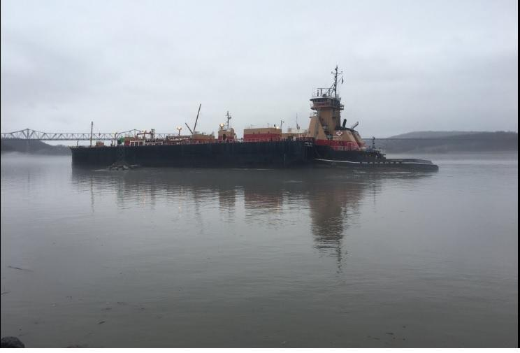 A barge run aground in the Hudson River in Catskill Tuesday.