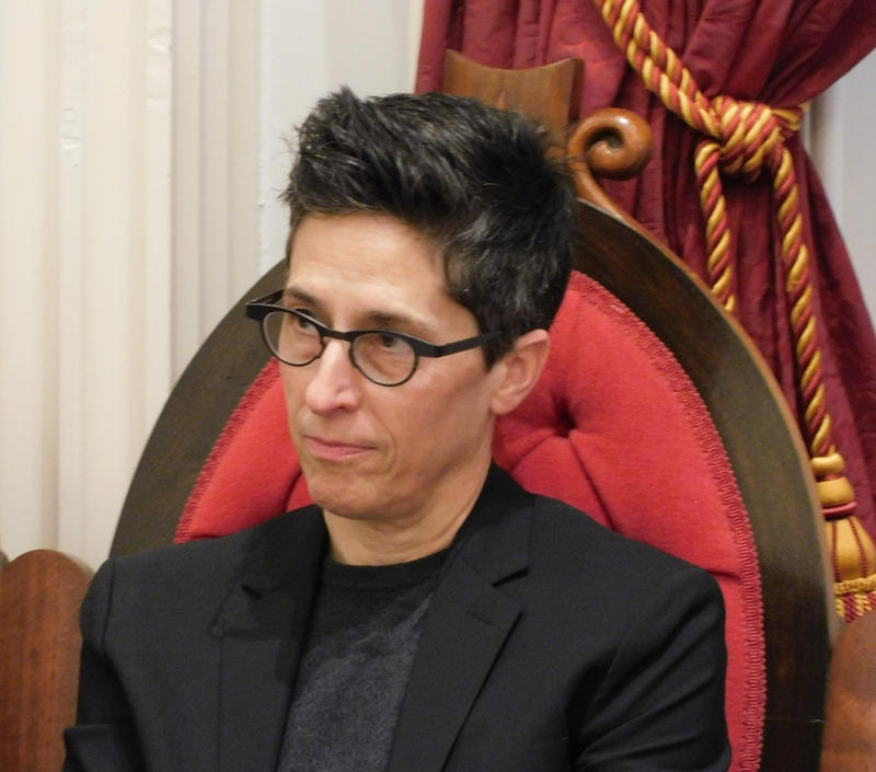 Alison Bechdel listens as Clerk of the House reads proclamation naming her Vermont Cartoonist Laureate