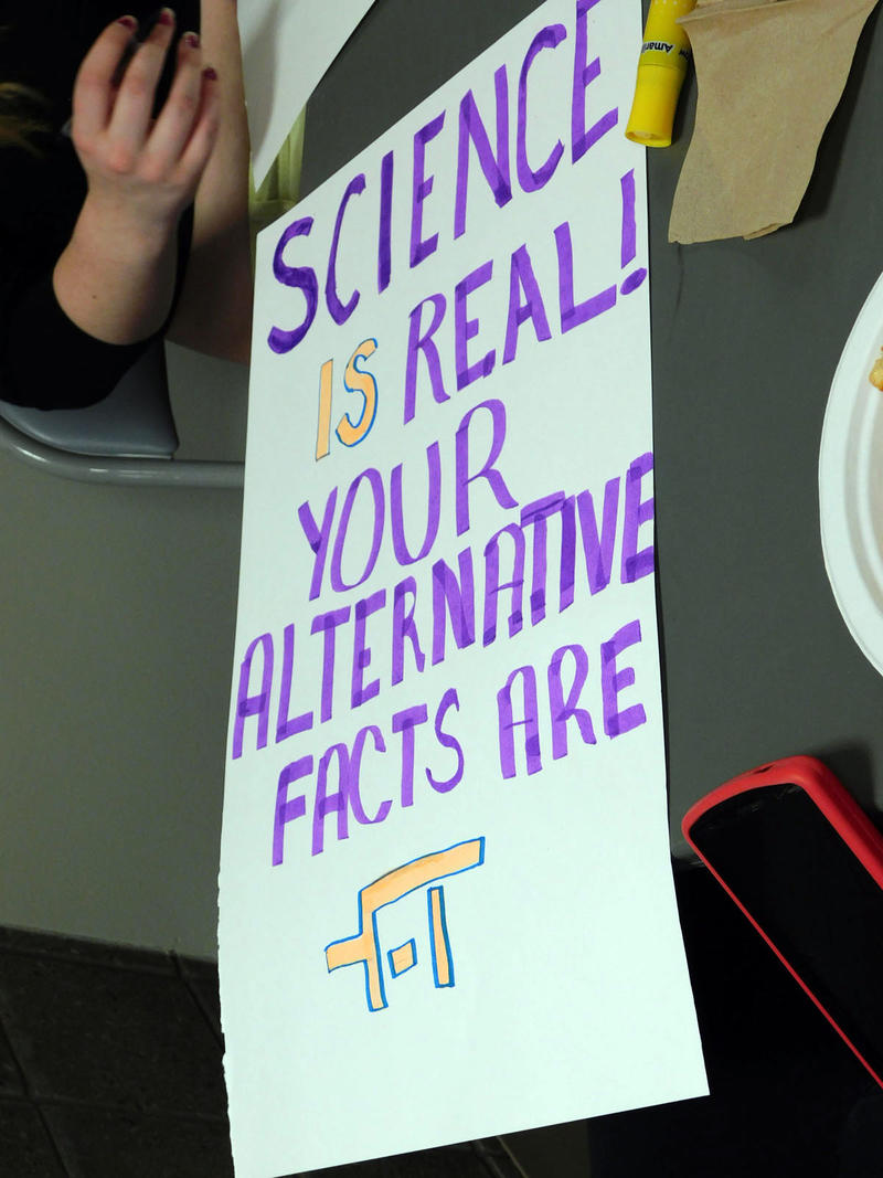 A sign being made for the March for Science