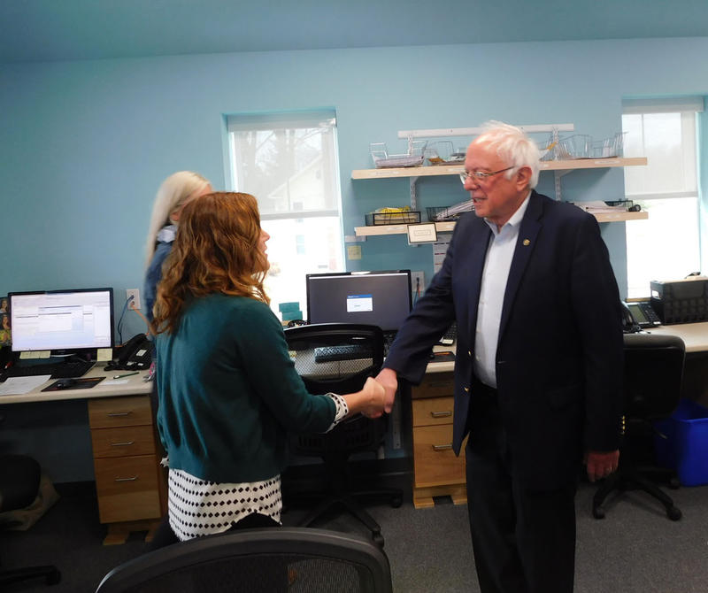 Senator Bernie Sanders (right) meets staff at the Champlain Islands Health Center