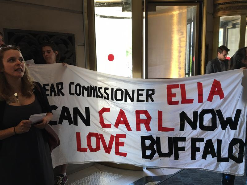 Protesters From Buffalo unfurl an anti-Carl Paladino banner May 17, 2017 in the lobby of the State Education Building In Albany.