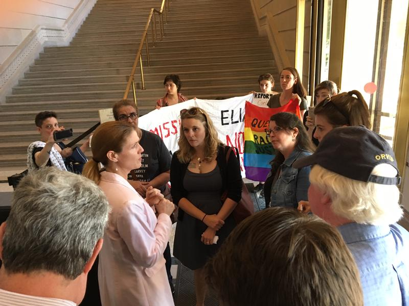 Executive Deputy Commissioner Elizabeth Berlin meets with demonstrators May 17, 2017 in the lobby of the State Education Building In Albany.