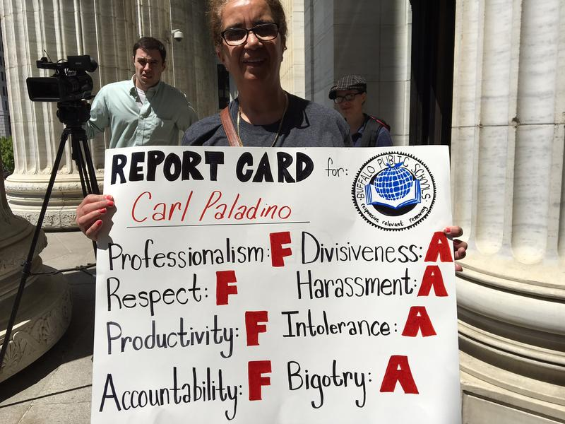 A protestor From Buffalo displays an antti-Carl Paladino poster May 17, 2017 on the steps to the State Education Building In Albany.