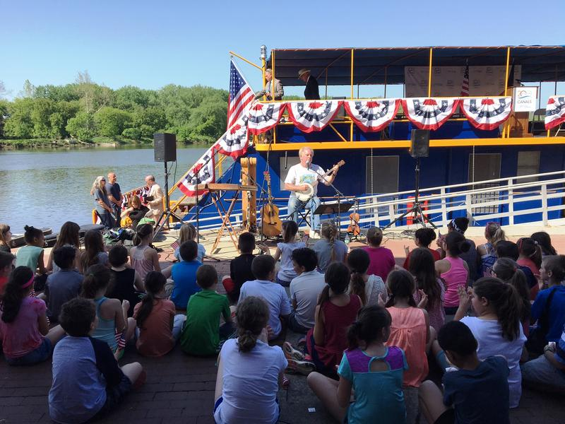 A group of schoolchildren were among those enjoying live entertainment along the canal shore.