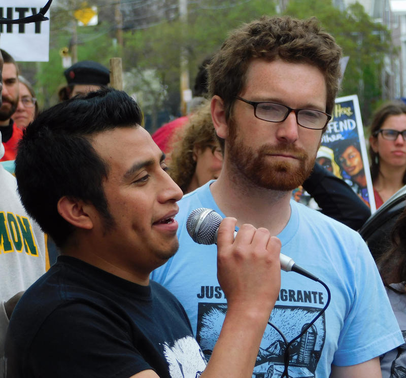 Enrique Balcazar (left) with translator Will Lambek at Burlington federal building rally