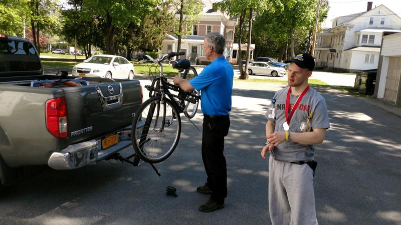 Chris Collins and Max Jaskoski deliver a bicycle in Glens Falls, New York