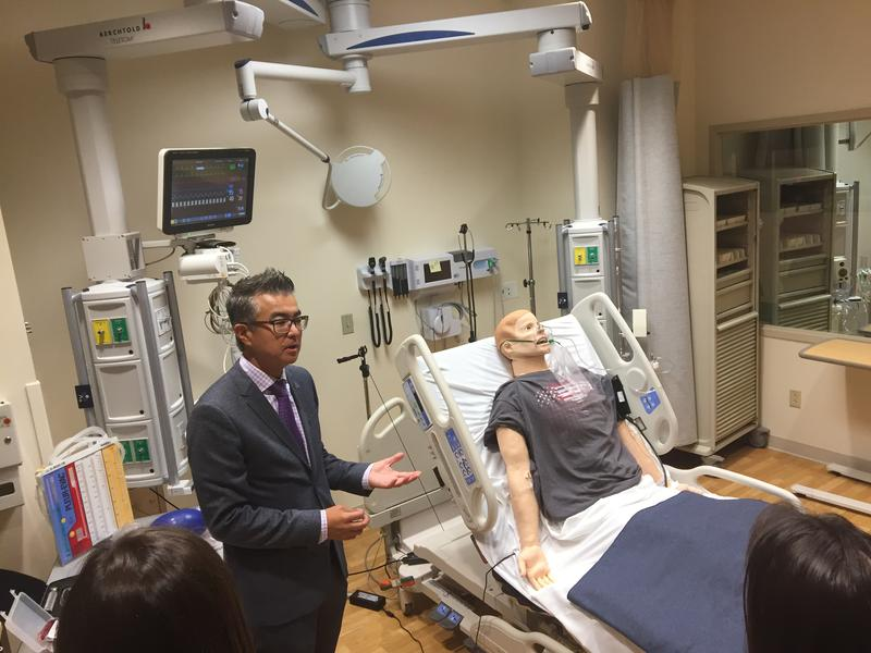 Dr. Haru Okuda demonstrating one of the simulation training room at the VA's SimLEARN Center near Orlando, Florida.