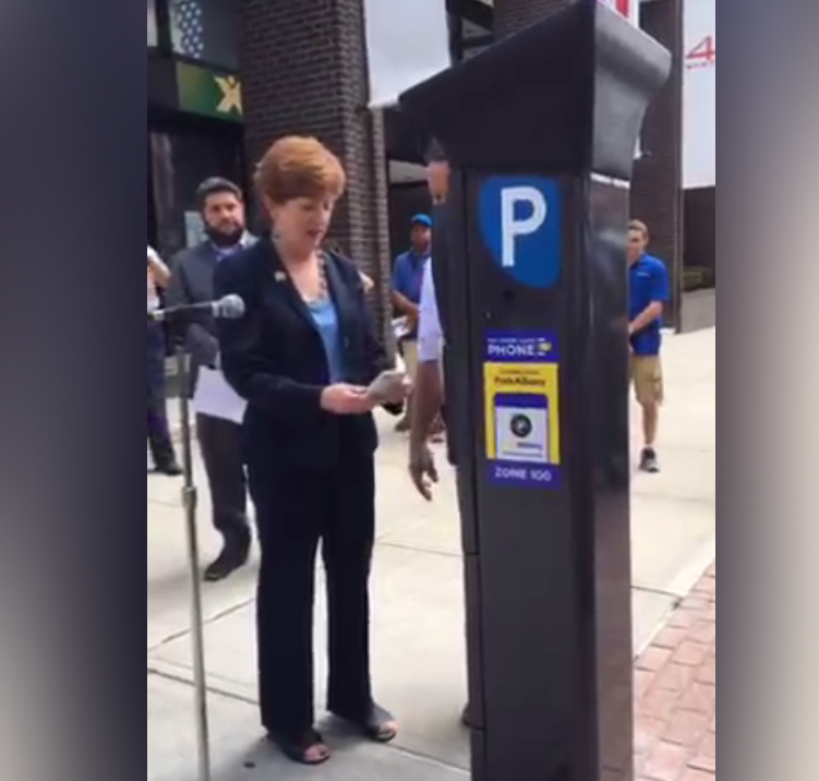 Albany Mayor Kathy Sheehan tries out the ParkAlbany app with on eof the city's 12 new experimental pay-by-phone parking meters.
