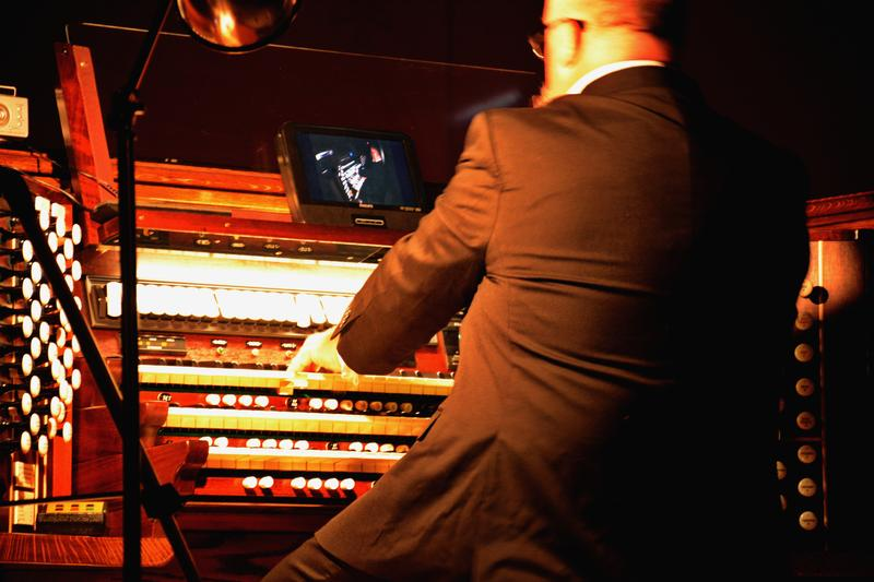 A close up on Peter Krasinski playing the organ.