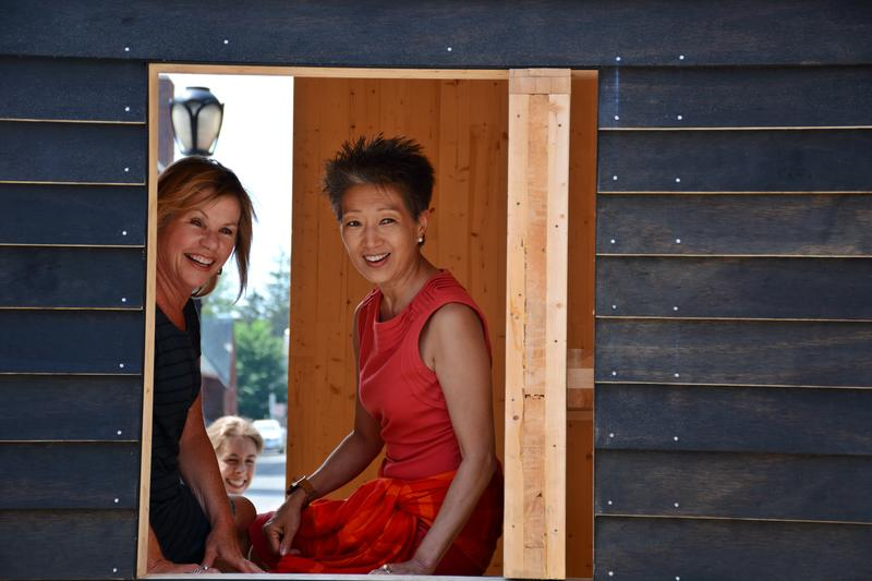 Massachusetts Cultural Council Executive Director Anita Walker and National Endowment for the Arts Chairwoman Jane Chu checking out a writers' stuido by Mastheads Writers Residency.