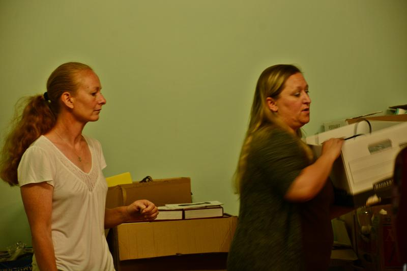 Hilary Greene and the new director Brooke Mead arrange files.