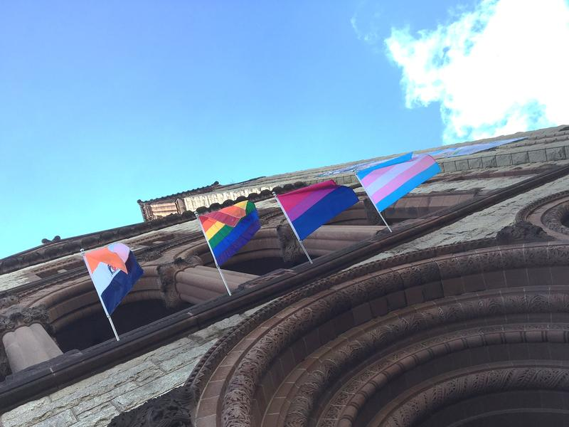 The City Flag flies alongside the Gay Pride flag, the Bisexual Pride flag, and the Transgender Pride flag on Albany City Hall.