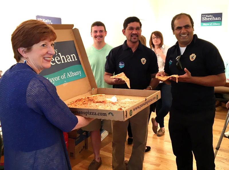 Mayor Kathy Sheehan rallied with supporters Sunday afternoon at her Madison Avenue campaign headquarters - chit-chatting and serving slices of pizza.