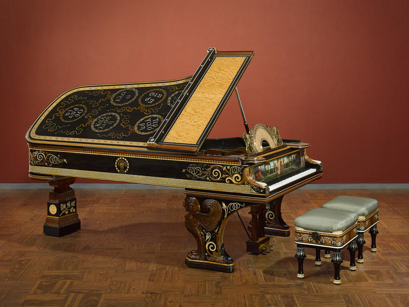 This is a photo of a Steinway piano designed by Lawrence Alma-Tadema.