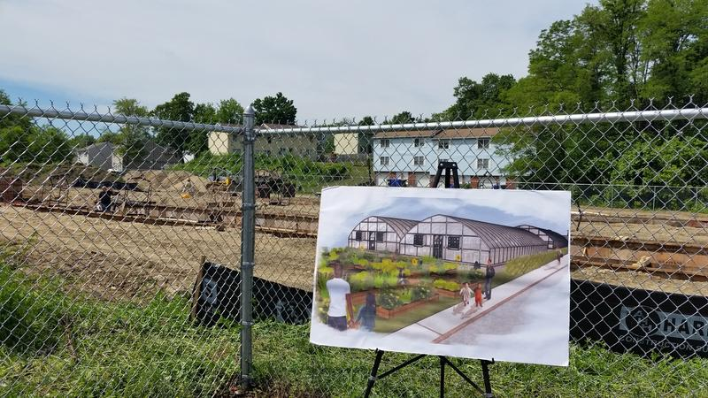 An artist's rendering depicts the finished Wellspring Harvest worker cooperative greenhouse at the actual construction site in the Indian Orchard neighborhood of Springfield, MA.