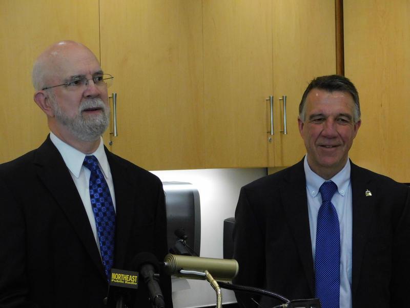 Representative Bill Lippert (left) and Governor Phil Scott discuss telemedicine bill