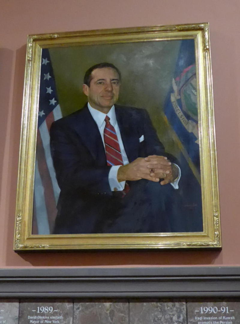 Governor Mario Cuomo's portrait hangs in the Hall of Governors at the State Capitol