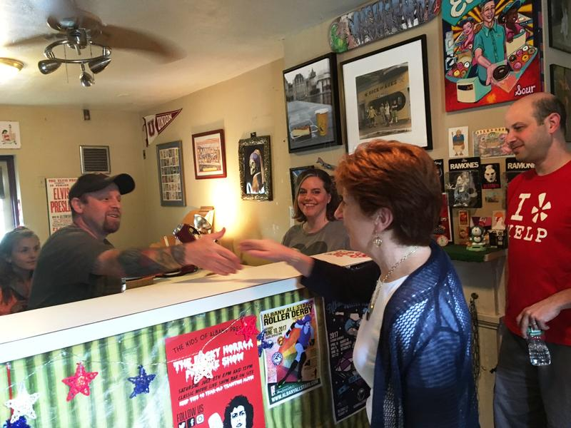Albany Mayor Kathy Sheehan congratulates Bam Lynch inside Cheescake Machsimo, June 30, 2017.