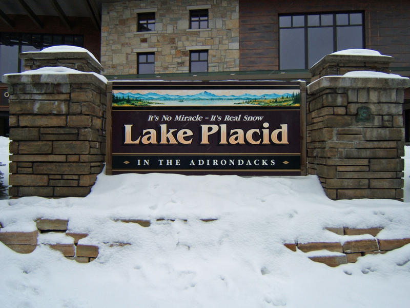 Lake Placid sign with snow