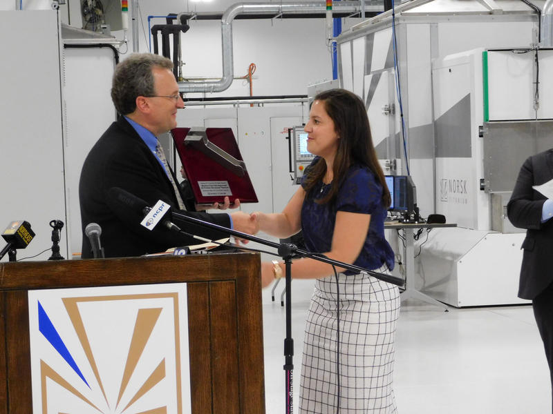 Norsk Titanium's Warren Boley presents Congresswoman Stefanik with plaque