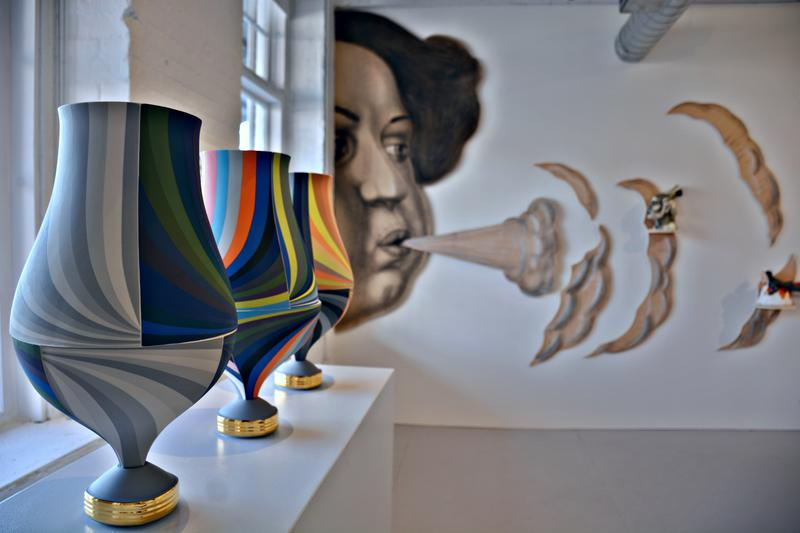 """Isupov's """"Exhale"""" in the backdrop of vases by Peter Pincus."""