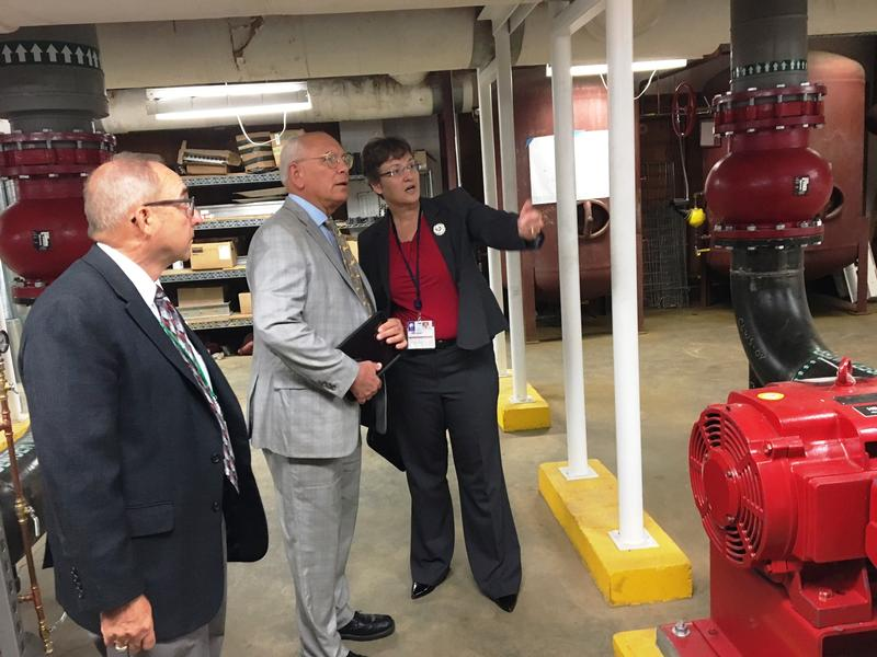 Karen Seward, who oversees facilities engineering at AMC, took Tonko and  on a tour of Albany Med's on-site chilled water facility. Albany Water Commissioner Joe Coffey looks on.