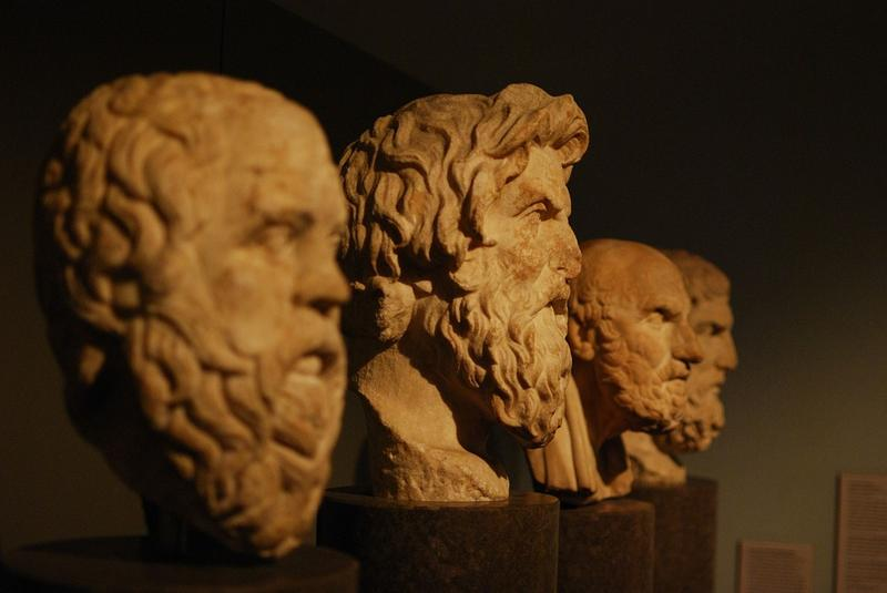 Aristotle and busts of famous philosophers