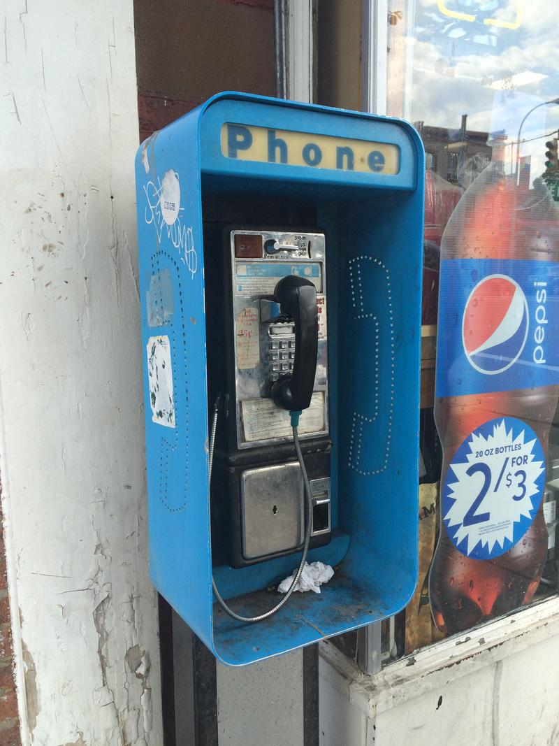 Another Albany payphone, now getting more use as a trash can than a phone.