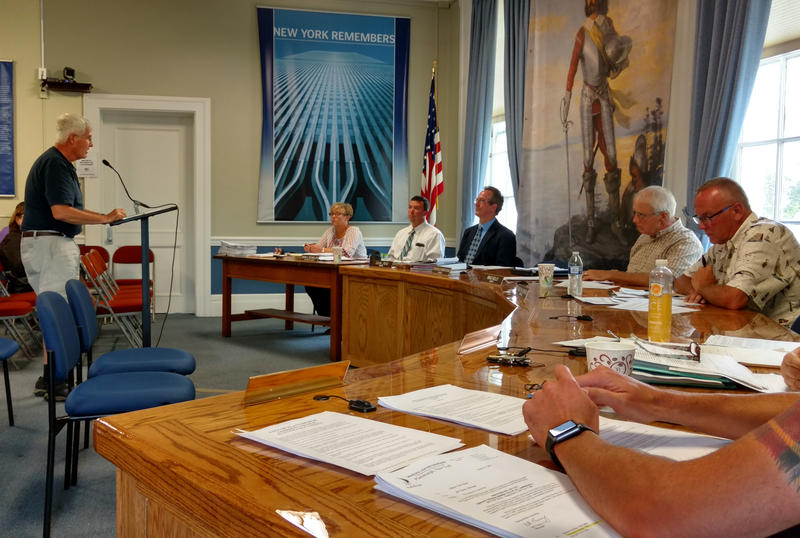 John Linney (left) speaks to Plattsburgh mayor and city councilors