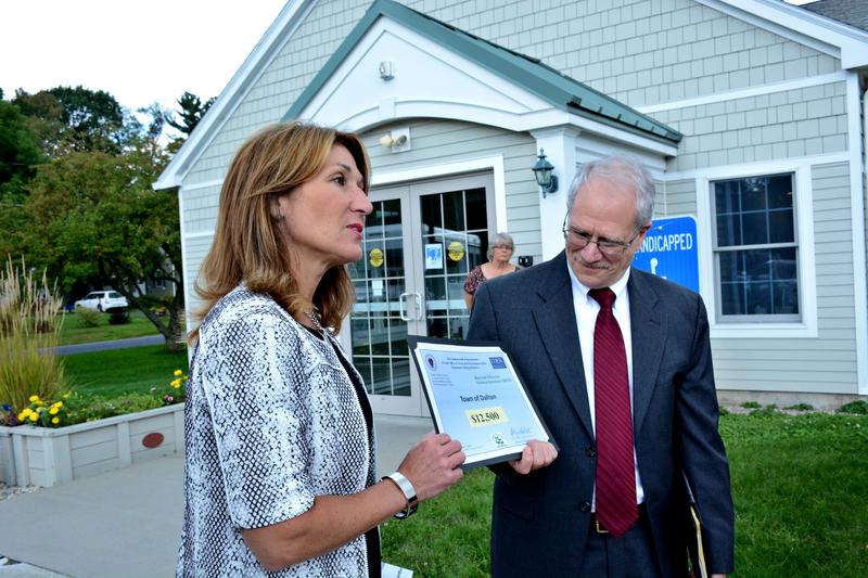 Lieutenant Governor Karyn Polito gives Dalton Town Manager Ken Walto a $12,000 grant for clean energy projects.